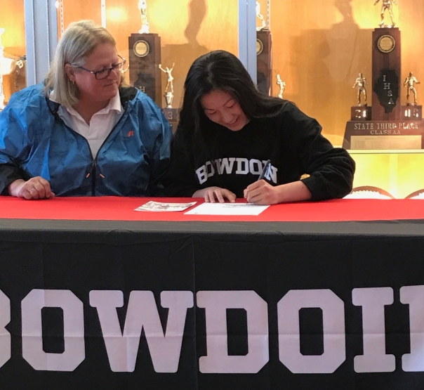 Kate Kiser signs her National Letter of Intent to play volleyball at Bowdoin College