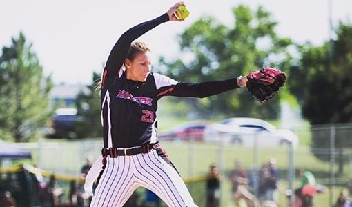 In fastpitch pitching, the ball faces forward, not toward second base, at the top of the circle